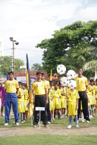 Children from different areas who will be participating in the programme in club jerseys